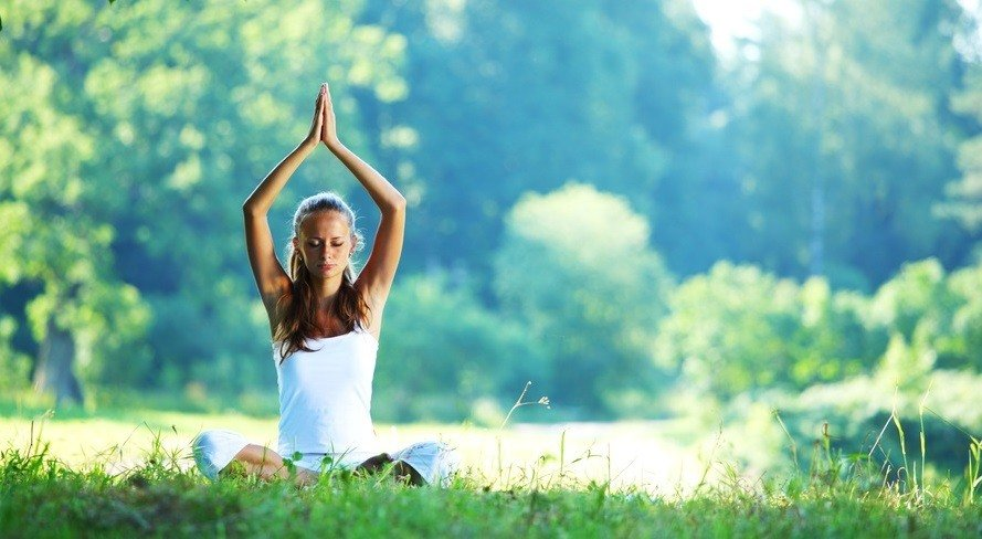 woman doing yoga in nature